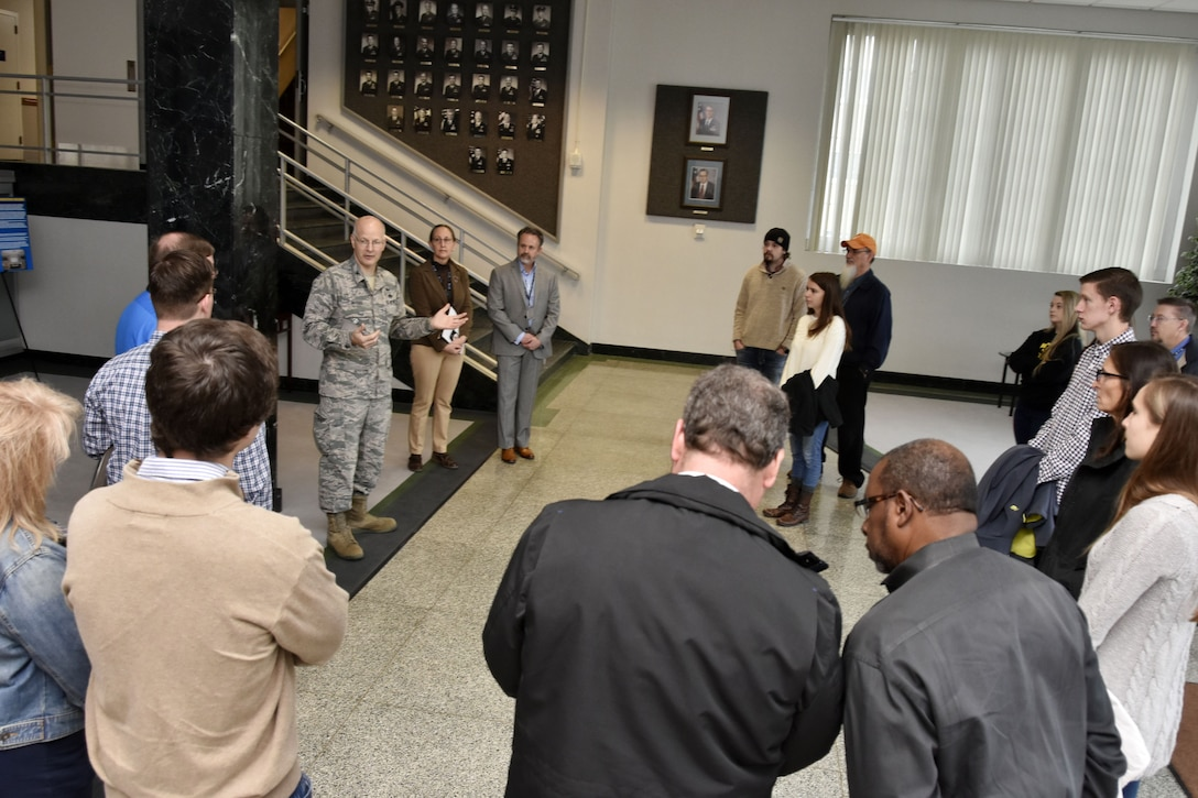 Col. Raymond Briggs, pictured in center left, welcomes the Bridge to the Future participants to Arnold Air Force Base. The event, for college-aged students of AEDC team members, was held Dec. 18 at Arnold to give prospective AEDC team members a chance to learn about the Complex and the career opportunities available. (U.S. Air Force photo/Rick Goodfriend)