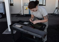 U.S. Air Force Airman Devin Matheny, an aerospace ground equipment apprentice assigned to the 6th Maintenance Squadron, prepares her tools for the day at MacDill Air Force Base, Fla., Nov. 1, 2017.