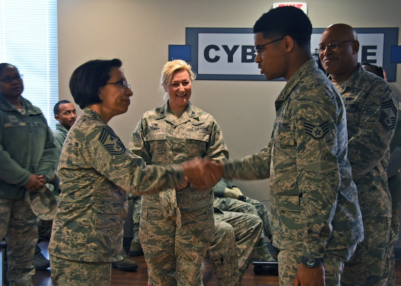 Chief Master Sgt. Ericka Kelly, Air Force Reserve Command command chief master sergeant, presents a coin to a non-commissioned officer from the 94th Aeromedical Staging Squadron  at Dobbins Air Reserve Base, Ga., Jan. 7, 2018. Kelly presented him with a coin for his outstanding achievements at the 94th ASTS. (U.S. Air Force photo by Staff Sergeant Miles Wilson)