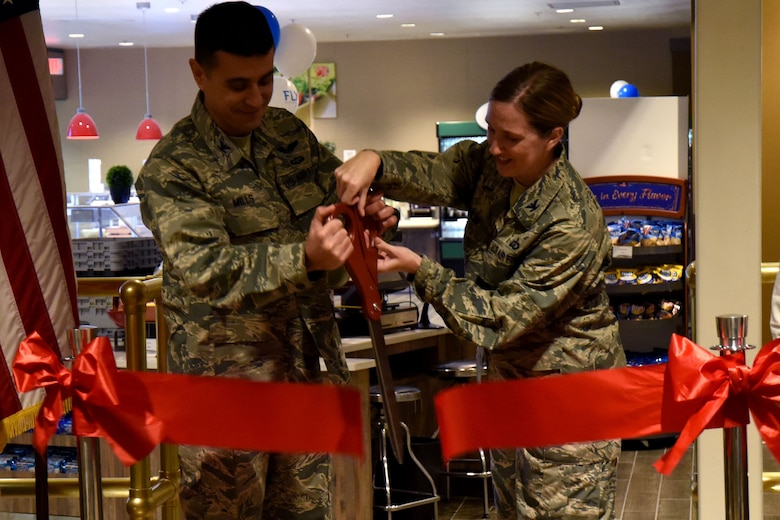 U.S. Air Force Col. Ricky Mills, 17th Training Wing commander, and Col. Julie Newlin, Air Force Services Activity director of operations, cut the ribbon officially opening the Western Winds Dining Facility on Goodfellow Air Force Base, Texas, Jan. 8, 2018. This marked a conclusion of 3 years work and $5.3 million in renovations. (U.S. Air Force photo by Airman 1st Class Seraiah Hines/Released)