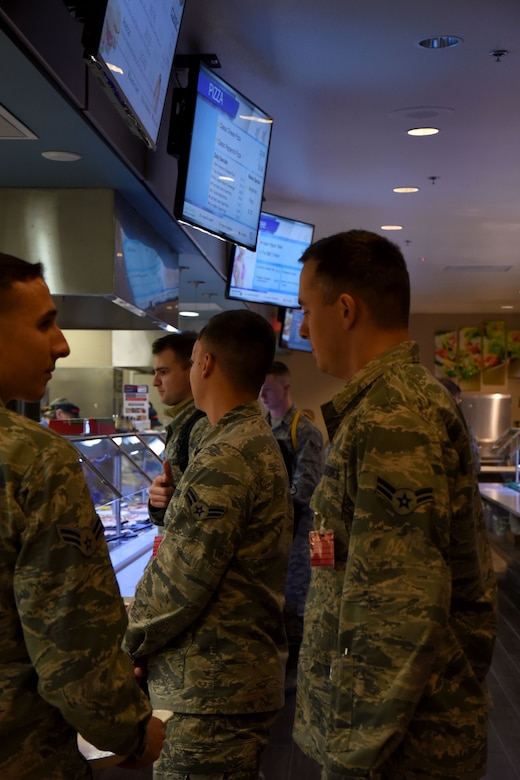 Diners take advantage of the new Western Winds Dining Facility stations at Goodfellow Air Force Base, Texas, Jan. 8, 2018. The stations include a grill where they can make a variety of options to the customer's liking, a salad bar, sub-sandwich station, and pizza by-the-slice. (U.S. Air Force photo by Airman 1st Class Seraiah Hines/Released)