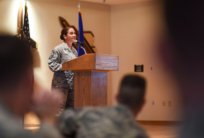 U.S. Air Force Senior Master Sgt. Angela Blue, 1st Maintenance Squadron first sergeant, speaks to Paul. W. Airey NCO Academy students during their graduation Dec. 20, 2017.