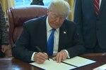 President Donald J. Trump signs an executive order.