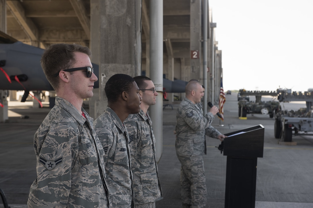 U.S. Air Force Tech. Sgt. Benjamin Bouvy, right, 18th Maintenance Group load standardization crew chief, introduces Airmen from the 67th Aircraft Maintenance Unit before an annual weapons load competition Jan. 3, 2018, on Kadena Air Base, Japan. Airmen from the 67th AMU competed against Airmen from the 44th AMU. (U.S. Air Force photo by Staff Sgt. Micaiah Anthony)
