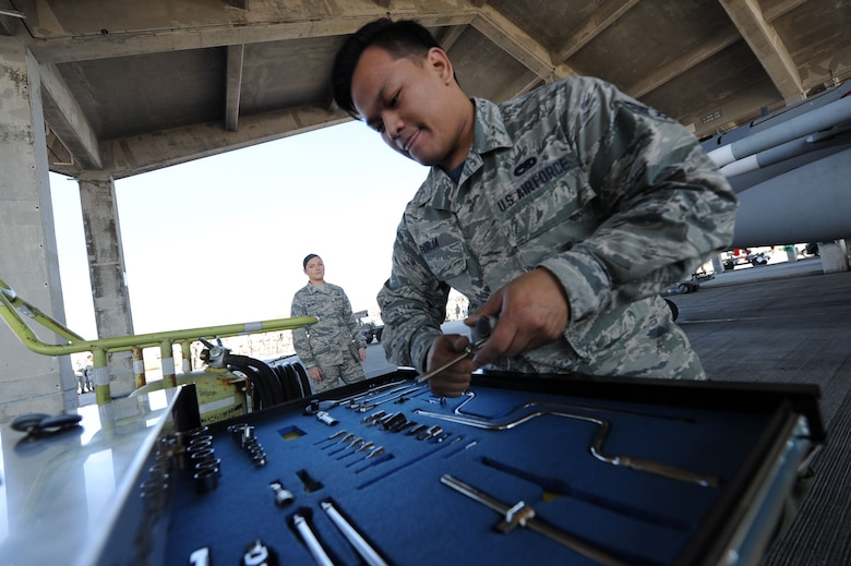 U.S. Air Force Senior Airman Melchorcrispin Borja, 44th Aircraft Maintenance Unit weapons load team member, inspects a tool box during an annual weapons load competition Jan. 3, 2018, on Kadena Air Base, Japan. Once the missiles are loaded, teams must ensure all tools are accounted for. (U.S. Air Force photo by Staff Sgt. Micaiah Anthony)