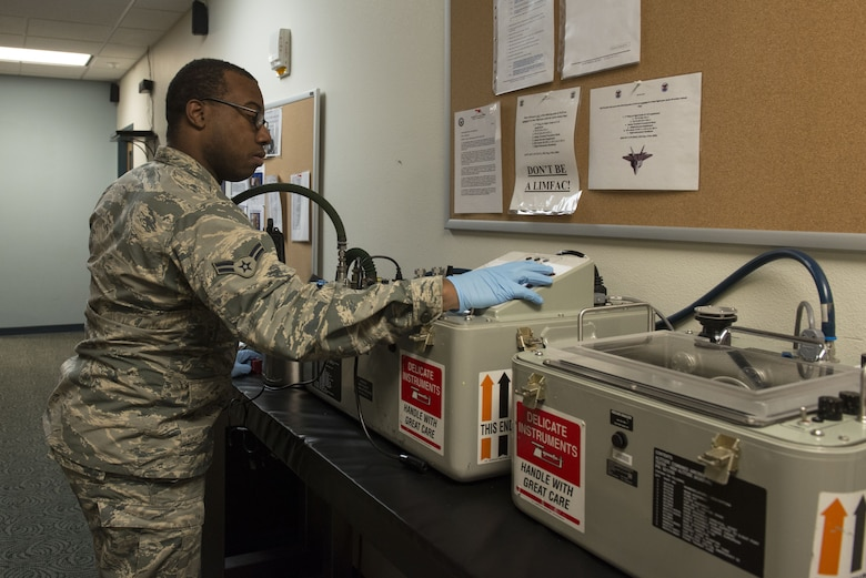 Airman 1st Class Jemal Ford, an aircrew flight equipment journeyman with the 3rd Operations Support Squadron, tests the operability of aircrew equipment at Joint Base Elmendorf-Richardson, Alaska, Jan. 5, 2018. AFE Airmen are responsible for maintaining, inspecting and servicing all equipment aircrew require while performing their duties.