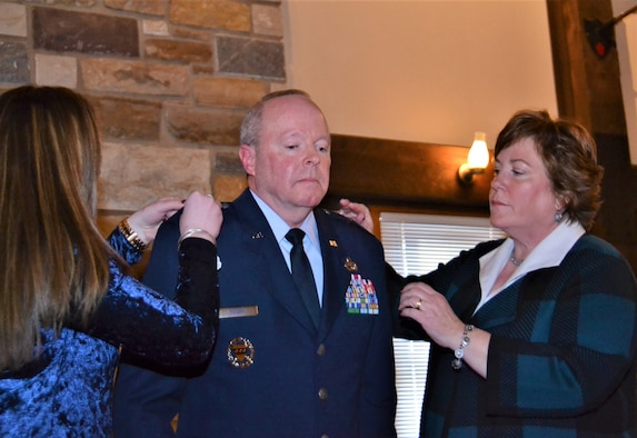 Pa. Air National Guard Commander Col. Mike Regan receives his one-star rank pinned on by his daughter, Emily, and wife, Lisa, during his promotion to brigadier general during a ceremony held at Fort Indiantown Gap, Pa., Jan 7, 2017. Enlisting in the Air Force in 1981, Regan joined the former 111th Fighter Wing, now the 111th Attack Wing, at Horsham Air Guard Station, Pa. before commissioning in 1994. (U.S. Air National Guard Tech. Sgt. Andria Allmond)