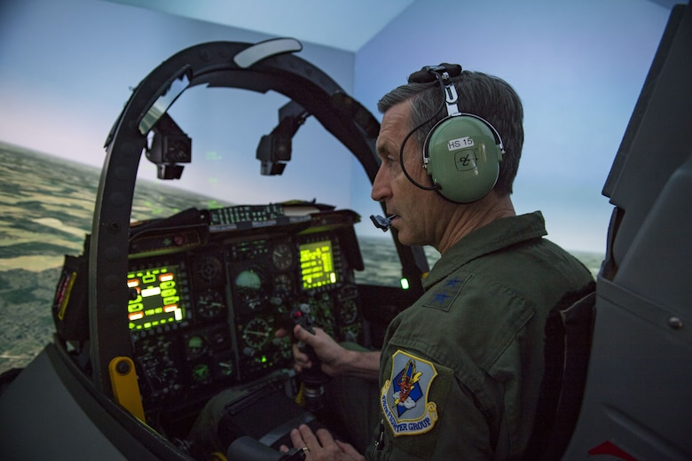 Maj. General Ronald Bruce Miller, 10th Air Force commander, looks to the side as he flies an A-10C Thunderbolt II during a simulated flight, Jan. 8, 2018, at Moody Air Force Base, Ga. The 10th Air Force leadership visited Moody to discuss the future deployments and changes to their units. (U.S. Air Force photo by Senior Airman Janiqua P. Robinson)