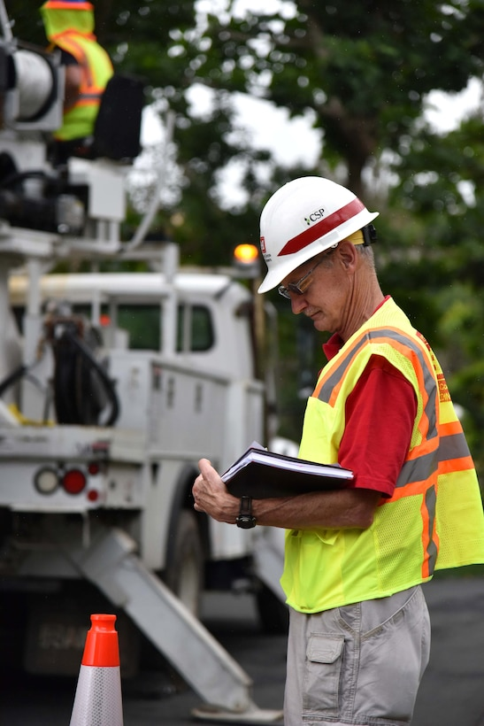 U.S. Army Corps of Engineers Task Force Power Restoration Safety Manager Bill Pioli, of Buffalo District, Buffalo, New York, goes over a Traffic Control Zone checklist while observing a MasTec crew at work in Naranjito, Puerto Rico, Jan. 6. Pioli and the task force safety team conducted an island-wide Traffic Control Zone Intervention to reduce the risk of traffic mishaps for electrical grid restoration teams working to restore power in Puerto Rico.