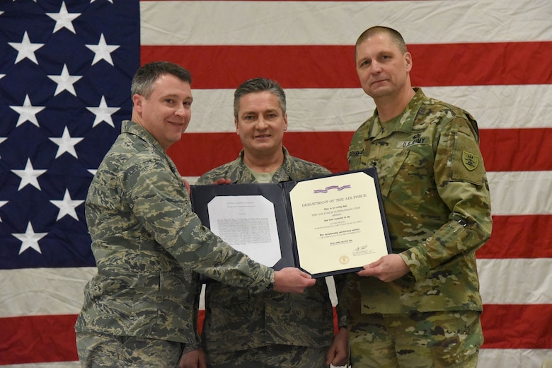 From left to right Col. Britt Hatley, the 119th Wing commander, Chief Master Sgt. Duane Kangas, the 119th Wing command chief, and Maj. Gen. Al Dohrmann, the North Dakota adjutant general, hold the Air Force Outstanding Unit Award certificate during a ceremony at the North Dakota Air National Guard Base, Fargo, North Dakota, Jan. 6, 2018.