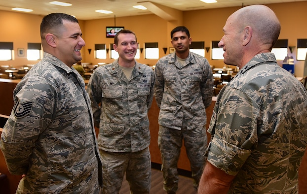 Gen. Mike Holmes, commander of Air Combat Command, speaks to Airmen selected as superior performers during his visit to Creech Air Force Base, Nev., Jan. 6, 2018. Holmes visited the Airmen of the 432nd Wing/432nd Air Expeditionary Wing to view Remotely Piloted Aircraft operations firsthand and to discuss the future of the enterprise. (U.S. Air Force photo/Senior Airman Christian Clausen)