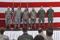 Command Chief Master Sgt. James McKay (left) joins 115th Fighter Wing Commander Col. Erik Peterson to recognise new unit members who earned the title of honor graduate in Basic Military Training during the unit's annual awards ceremony at Truax Field in Madison, Wisconsin, Jan. 6, 2017. The ceremony highlighted Airman from throughout the unit who displayed exemplary skill and leadership in the performance of their duties both at home, and in deployed locations around the world. (U.S. Air National Guard photo by Tech. Sgt. Andrea Rhode)