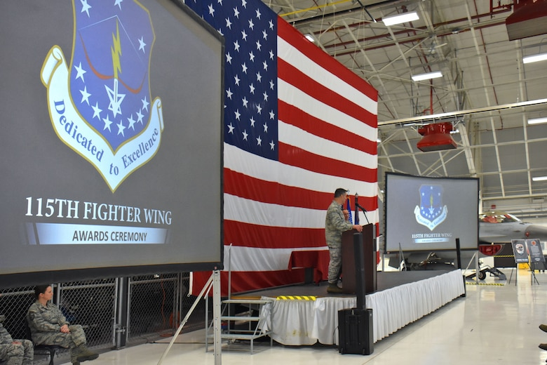 Col. Erik Peterson, commander of the Wisconsin Air National Guard's 115th Fighter Wing addresses unit members during the annual awards ceremony at Truax Field in Madison, Wisconsin, Jan. 6, 2017. The ceremony highlighted Airman from throughout the unit who displayed exemplary skill and leadership in the performance of their duties both at home, and in deployed locations around the world. (U.S. Air National Guard photo by Master Sgt. Paul Gorman)