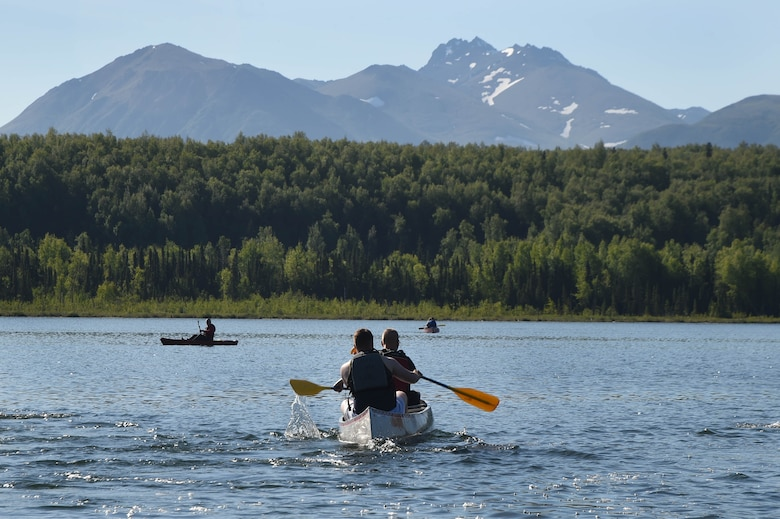 Community members use canoes at Otter Lake, Joint Base Elmendorf-Richardson, Alaska June, 17 2016. Programs such as iSportsman provide the public with tools necessary for undeveloped areas on base to be used for recreation opportunities, while also keeping both the public and military operations safe and thriving.