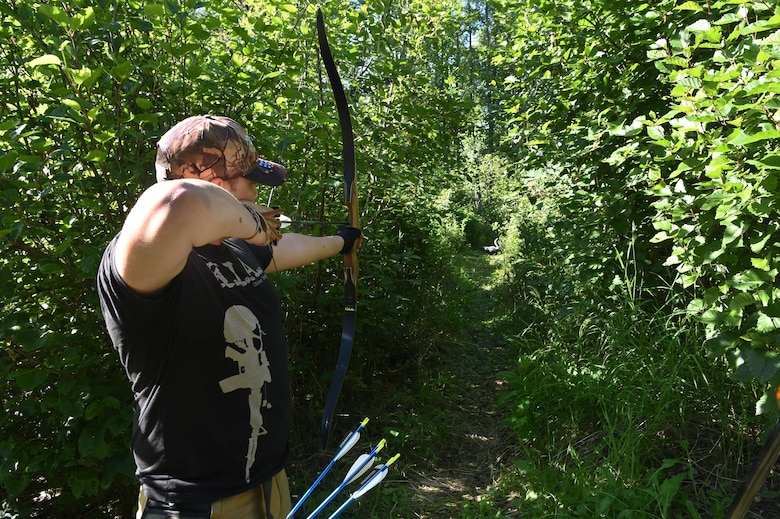 A service member uses undeveloped recreational areas for practicing archery at Joint Base Elmendorf-Richardson, Alaska June, 17 2016. Prior to any recreation on the base's undeveloped areas, individuals 16 years and older must register in the iSportsman system.