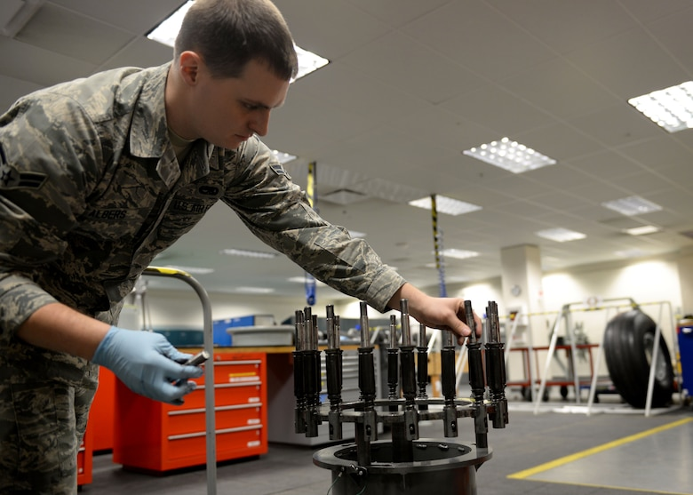 Airman 1st Class Clark Albers, C-17 Globemaster III crew chief and aerospace maintenance journeyman, sets up lugs using a wheel and tire assembly fixture in the Wheel and Tire Shop at Joint Base Elmendorf-Richardson, Alaska December 18, 2017. Crew chiefs inspect, assemble and disassemble all wheels and tires for repair.