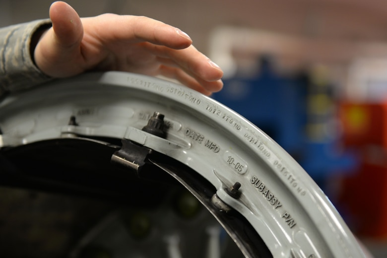 Airman 1st Class Clark Albers, C-17 Globemaster III crew chief and aerospace maintenance journeyman, inspects the removal due date tag of a C-17 Globemaster III wheel in the Wheel and Tire Shop at Joint Base Elmendorf-Richardson, Alaska December 18, 2017. If the RDD tag indicates the wheel is within a certain timeframe of needing replacement, it will be repaired in the shop.