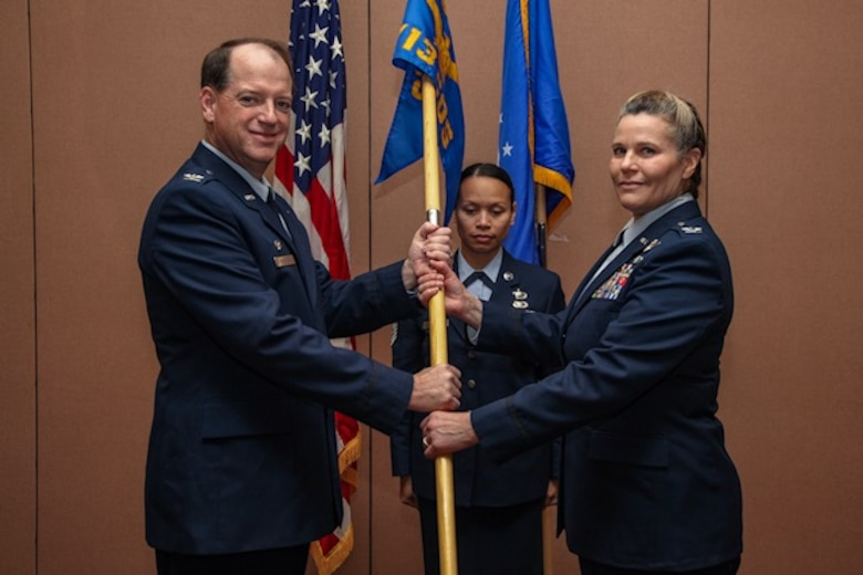 Col. Thomas McNamara, 610th Operations Group Commander, passed Col. Marty the flag as the presiding official.