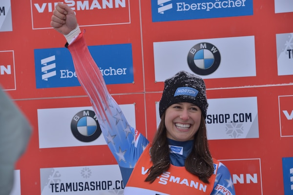 Sgt. Emily Sweeney waves to the crowd at the Lake Placid Olympic Center Dec. 16.