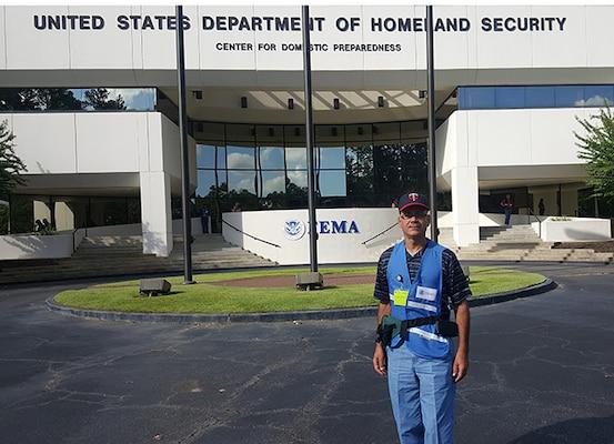 Employee volunteers with FEMA