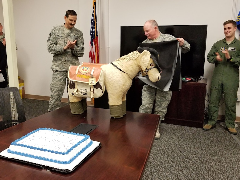 Chief Master Sgt. John Erwin unveils mascot