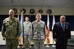 Navy Vice Adm. David Lewis, Defense Contract Management Agency director, left, held a change of leadership ceremony for the agency's Western Regional Command in Carson, California, Jan. 9. Air Force Col. David Learned, center, relieved David Devlin, right, as the region commander. (DCMA photo by Mark Jackson)