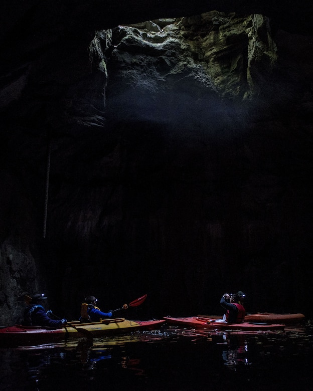 Kayakers with Scott Air Force Base Outdoor Recreation look up at an opening in a cavern, Sept. 23, 2017, at Crystal City Underground, an abandoned, submerged sandstone mine in Crystal City, Mo. The mine spans approximately 200 acres.  (U.S. Air Force photo by Airman 1st Class Tara Stetler)