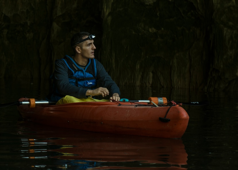 Senior Airman Benjamin Grondin, 375 Communications Squadron cyber transport technician, kayaks on a trip with Scott Air Force Base Outdoor Recreation, Sept. 23, 2017, at Crystal City Underground, an abandoned, submerged sandstone mine in Crystal City, Mo. The yellow tarp he wears over his lap is there to keep the water off of him, as the mine temperatures remain below 60°F year-round. (U.S. Air Force photo by Airman 1st Class Tara Stetler)
