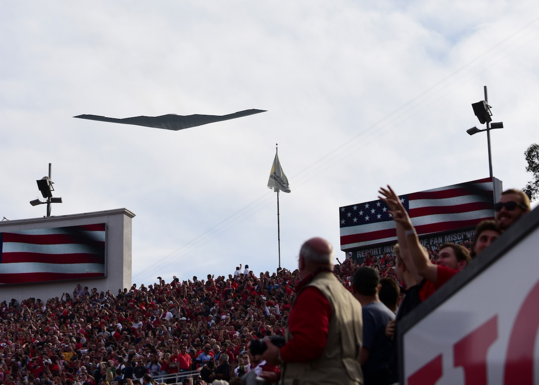 "A B-2 Spirit from Whiteman Air Force Base, Mo., opens the 104th Rose Bowl with a flyover in Pasadena, Calif., Jan. 1, 2018. The B-2 also performed a flyover for the 129th Rose Parade earlier in the day with two F-35 Lightning IIs from Edwards AFB, Calif., to honor U.S. Air Force Maj. Benjamin ""Chex"" Meier, a pilot assigned to the 31st Test and Evaluation Squadron, and other donors who have given the gift of life to others. (U.S. Air Force photo by Staff Sgt. Danielle Quilla)"