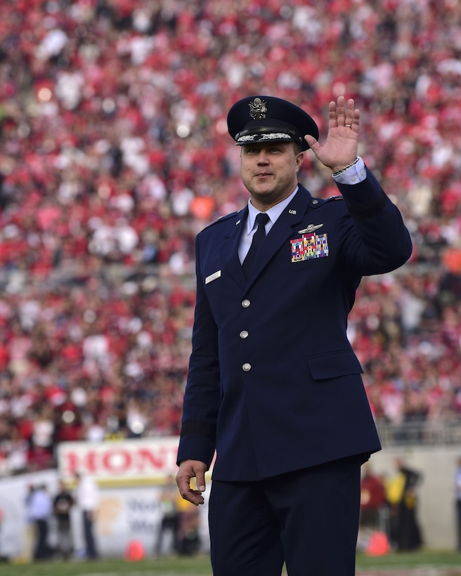 U.S. Air Force Brig. Gen. John Nichols, the 509th Bomb Wing commander, waves to a stadium full of Georgia Bulldogs and Oklahoma Sooners fans after the first quarter of the 104th Rose Bowl in Pasadena, Calif., Jan. 1, 2018. Nichols represented Whiteman Air Force Base along with the B-2 Spirit flyover for the New Year's event. (U.S. Air Force photo by Staff Sgt. Danielle Quilla)