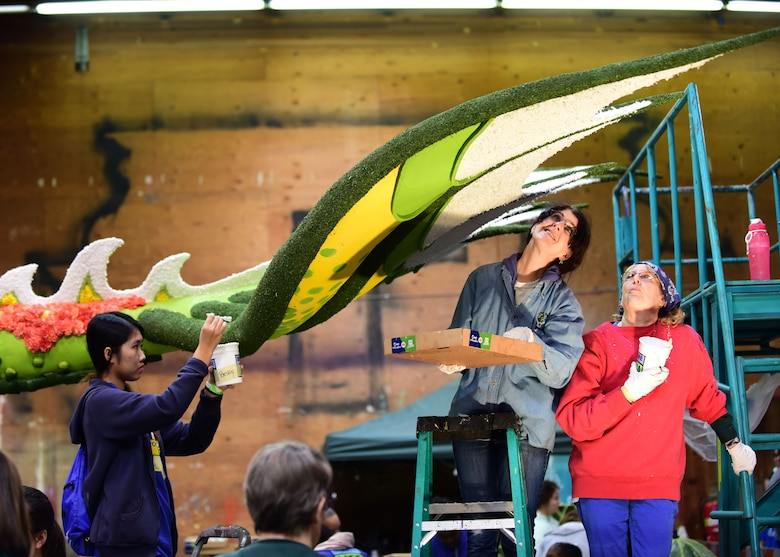 Volunteers apply finishing touches to the tail of the dragon featured in the UPS Store, Inc. float as part of the 2018 Rose Parade in Pasadena, Calif., Dec. 30, 2017. Every square inch of the floats that are exposed must be coved with flowers or other natural material, such as the grapefruit, oranges, lemons and limes used in the UPS Store, Inc. float. (U.S. Air Force photo by Staff Sgt. Danielle Quilla)
