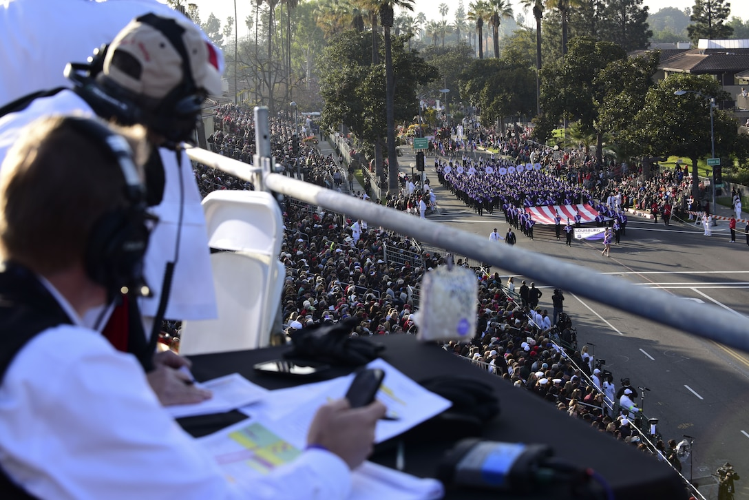 Parade coordinators keep track of the 2018 Rose Parade progress at Pasadena, Calif., Jan. 1, 2018. The 2018 Rose Parade theme was Making a Difference, which celebrated all the people in community who quietly, and without desire for award, act in selfless, generous ways to aid others. (U.S. Air Force photo by Staff Sgt. Danielle Quilla)