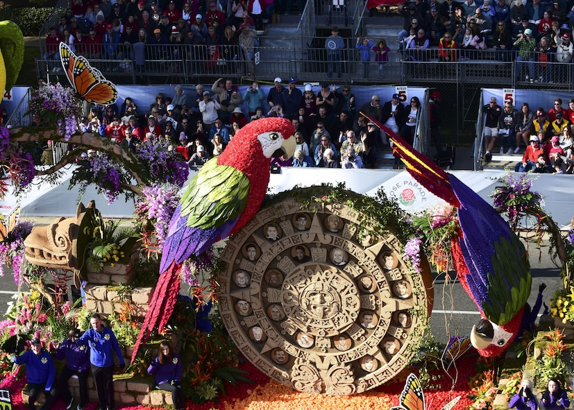 """The Donate Life float with the theme of """"The Gift of Time"""" travels down the parade route during the 2018 Rose Parade in Pasadena, Calif., Jan. 1, 2018. The theme celebrates the people who become organ, eye and tissue donors and made a difference in the lives of others. U.S. Air Force Maj. Benjamin """"Chex"""" Meier, a pilot assigned to the 31st Test and Evaluation Squadron, is among the donors who were honored in the float design. (U.S. Air Force photo by Staff Sgt. Danielle Quilla)"""