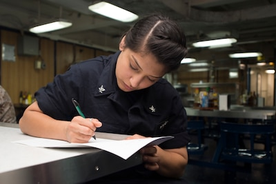 PACIFIC OCEAN (June 04, 2015) Engineman 3rd Class Andrea Gasca completes a written damage control test aboard Whidbey Island-class amphibious dock landing ship USS Rushmore (LSD 47). The Essex Amphibious Ready Group is currently operating in the 7th fleet area of responsibility.  (U.S. Navy photo by Mass Communication Specialist 3rd Class Chelsea Troy Milburn/Released)