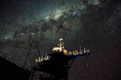 170721-N-UX013-703 CORAL SEA (July 21, 2017) The amphibious dock landing ship USS Ashland (LSD 48) patrols waters off the coast of Australia under a stars-lit night during Talisman Saber 17. Talisman Saber is a biennial U.S.-Australia bilateral exercise held off the coast of Australia meant to achieve interoperability and strengthen the U.S.-Australia alliance. (U.S. Navy photo by Mass Communication Specialist 3rd Class Jonathan Clay/Released)