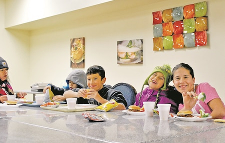 Kids chow down on sloppy joes, chips and veggies during the No Dough Dinner Dec. 13 at the Culinary Arts Lab.