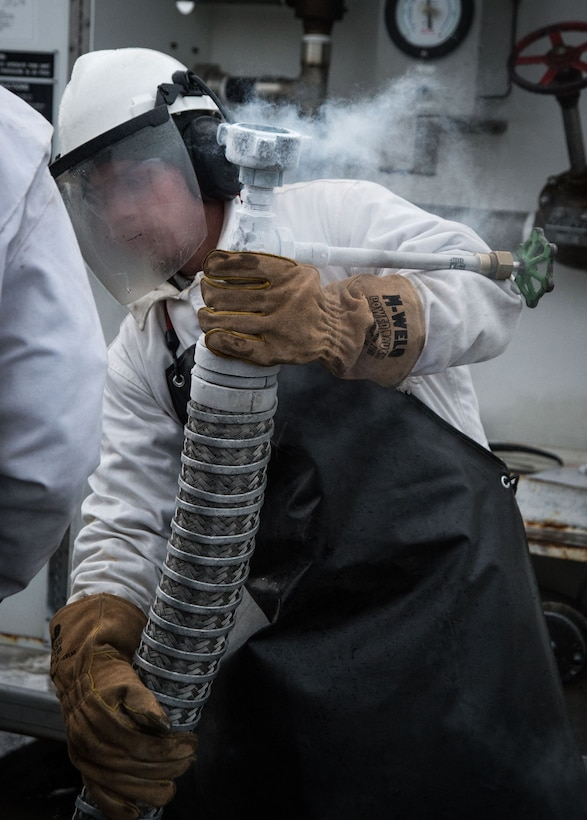 U.S. Air Force Airman 1st Class Jerry Timmons, 673d Logistics Readiness Squadron fuels facilities technician, prepares to fill a 50-gallon liquid oxygen cart at Joint Base Elmendorf-Richardson, Alaska, Dec. 4, 2017. Oxygen is pressurized and cooled into a liquid state in order to transport it more efficiently from cryogenic tanks to JBER's aircraft to provide fresh air to pilots in flight.