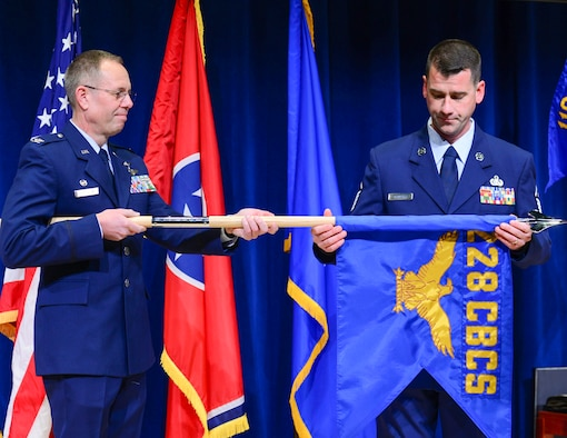Col. Vincent Franklin, out-going 119th Cyberspace Operations Squadron Commander, and MSgt Eric Konupka, 119th First Sergeant, retire the 228th Combat Control Squadron guidon. The 228 CBCS was officially retired in a ceremony on Jan. 6, 2018, at McGhee Tyson Air National Guard Base. (U.S. Air National Guard photo by TSgt Daniel Gagnon.)