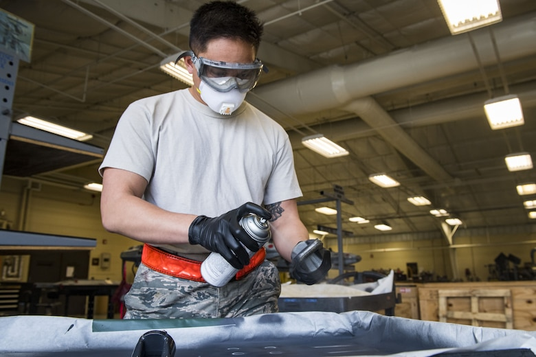 Airman 1st Class Vernon Datu, 23d Maintenance Squadron gun element member, paints metal elements with anti-corrosion spray, Jan. 10, 2018, at Moody Air Force Base, Ga. Moody's armament flight is responsible for maintaining all of the aircraft weapons systems components when they're removed from the aircraft. This includes gun systems, alternate mission equipment and bomb racks. (U.S. Air Force photo by Senior Airman Janiqua P. Robinson)