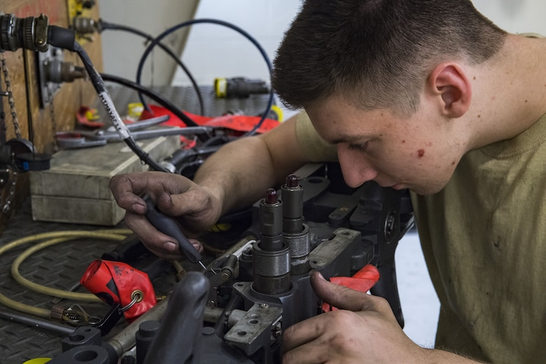 Airman 1st Class Tanner Chilcote, 23d Maintenance Squadron armament journeyman, checks electrical components on a bomb rack, Jan. 10, 2018, at Moody Air Force Base, Ga. Moody's armament flight is responsible for maintaining all of the aircraft weapons systems components when they're removed from the aircraft. This includes gun systems, alternate mission equipment and bomb racks. (U.S. Air Force photo by Senior Airman Janiqua P. Robinson)