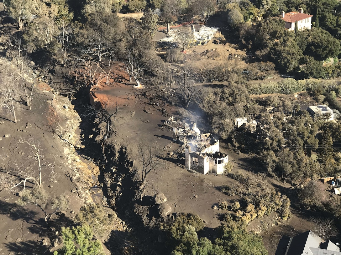 A California Air National Guard HH-60G Pave Hawk rescue helicopter with air crews and  two elite Guardian Angel pararescuemen from the 129th Rescue Wing Moffett Air National Guard Base, Calif, provide search and rescue operations in Southern California, impacted by a mudslides, Jan. 10, 2018.