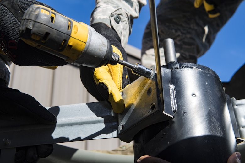 Airmen from the 23d Civil Engineer Squadron secure a fan motor, Jan. 10, 2018, at Moody Air Force Base, Ga. The equipment that keeps Moody comfortable indoors is designed for a climate that is typically warm year round, but when temperatures fall below 40 degrees, the equipment starts to malfunction. With temperatures recently dipping into the low teens and snow falling this winter for the first time since 2010, Airmen who work in Moody's Heating, Ventilation and Air Conditioning flight credit the weather for the busy winter they're having. (U.S. Air Force photo by Senior Airman Janiqua P. Robinson)
