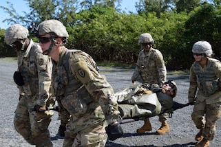 Marine Corps combat medics assigned to the 25th Combat Aviation Brigade, 25th Infantry Division undergo medical evacuation training on Marine Corps Training Area Bellows, Hawaii, Jan. 10, 2018. The soldiers used a Black Hawk helicopter idling in place, which added a realistic aspect to the training mission. Marines Corps photos by Staff Sgt. Armando R. Limon