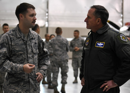Air Force Chief of Staff Gen. David L. Goldfein speaks to Tech. Sgt. Stephen, 432nd Aircraft Communications Maintenance Squadron, mission defense team lead, about a new Remotely Piloted Aircraft initiative during his visit to Creech Air Force Base, Nev., Jan. 9, 2018. Goldfein visited the Airmen of the 432nd Wing/432nd Air Expeditionary Wing to view RPA operations firsthand and to discuss the future of the enterprise. (U.S. Air Force photo/Master Sgt. Nadine Barclay)