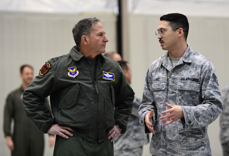 Air Force Chief of Staff Gen. David L. Goldfein discusses MQ-9 Reaper avionics from Staff Sgt. Michael, 432nd Aircraft Maintenance Squadron avionics technician, Jan. 9, 2017, at Creech Air Force Base, Nev. Goldfein toured operational squadrons around the base to meet with 432nd Wing/432nd Air Expeditionary Wing and 799th Air Base Group Airmen.  (U.S. Air Force photo/Senior Airman Christian Clausen)