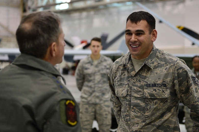 Air Force Chief of Staff Gen. David L. Goldfein shares a laugh with Staff Sgt. Steven, 432nd Aircraft Maintenance Squadron aircraft technician, Jan. 9, 2017, at Creech Air Force Base, Nev. Goldfein visited to see operations firsthand and discuss the future of the Remotely Piloted Aircraft enterprise. (U.S. Air Force photo/Airman 1st Class Haley Stevens)
