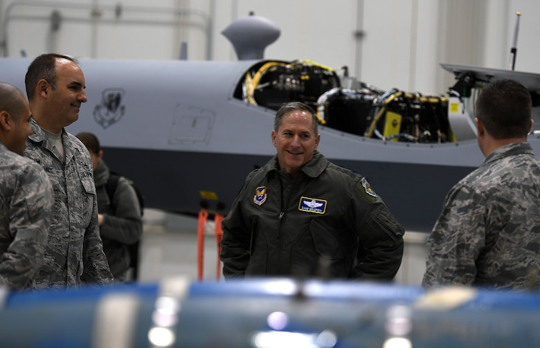 Air Force Chief of Staff Gen. David L. Goldfein speaks to Col. Matthew, 432nd Maintenance Group commander, about the benefits of deploying MQ-9 Reapers in the fight against Islamic State of Iraq and Syria during his visit to Creech Air Force Base, Nev., Jan. 9, 2018. Goldfein visited with the 432nd Wing/432nd Air Expeditionary Wing and 799th Air Base Group Airmen who deliver persistent attack and reconnaissance 24/7/365 against the nation's enemies. (U.S. Air Force photo/Master Sgt. Nadine Barclay)