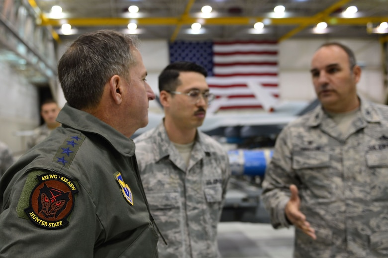 Air Force Chief of Staff Gen. David L. Goldfein speaks to Col. Matthew, 432nd Maintenance Group commander, Jan. 9, 2017, at Creech Air Force Base, Nev. Goldfein visited with the 432nd Wing/432nd Air Expeditionary Wing and 799th Air Base Group Airmen who deliver persistent attack and reconnaissance 24/7/365 against the nation's enemies.  (U.S. Air Force photo/Airman 1st Class Haley Stevens)