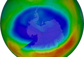 A graphic of the Earth shows a large purple and blue circle which are areas with the least ozone.