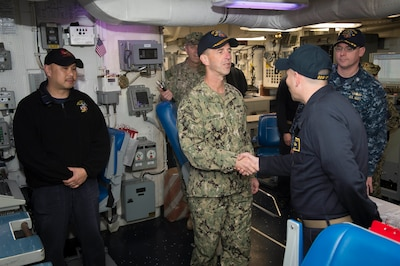Chief of Naval Operations Adm. John M. Richardson speaks to a sailor
